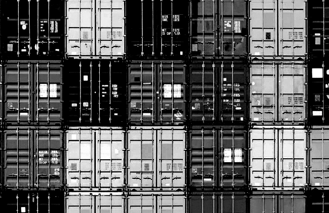 Stacked shipping containers, and one being held above them. Concepts of rising above the crowd, being better than the rest, or where shall I put this? These are normal scruffy used shipping containers, tidy and cleaned up, but not new or perfect.